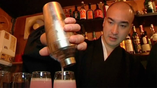 Priest pouring cocktails in Tokyo bar